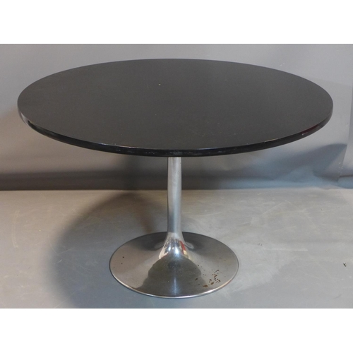 66 - A Swedish Johanson Design Tulip dining table, with black circular top raised on chrome support and s...