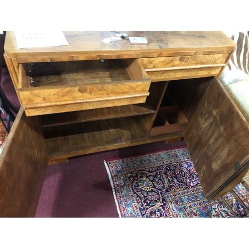67 - An Art Deco walnut sideboard, the quarter veneered top above two drawers and two cupboard doors, rai...