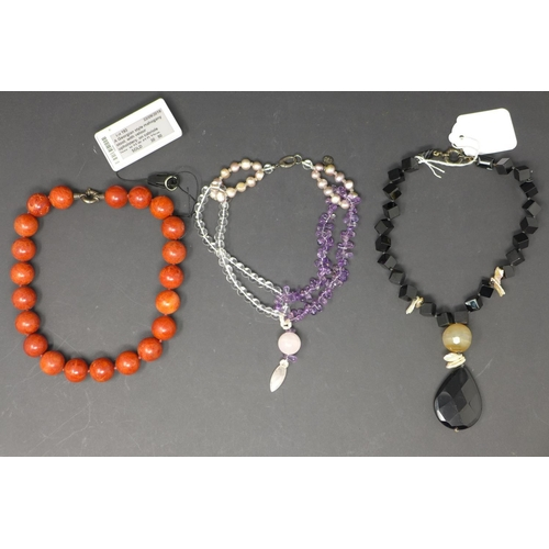 193 - A black stoned strung necklace together with another necklace and a bracelet....