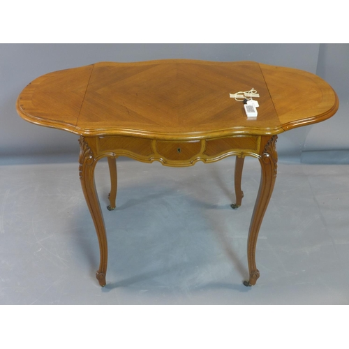 70 - A French walnut serpentine side table, the quarter veneered top with two drop leaves, having single ...