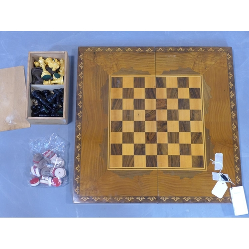 325 - A marquetry inlaid walnut backgammon board, with chess board to top, having counters, H.8 W.55 D.27c...