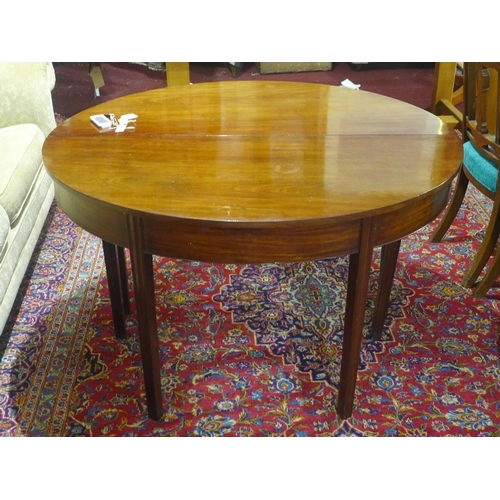 29 - A mahogany D-end dining table, with extra leaf, raised on tapered legs, H.73 W.127cm, leaf depth 73c...