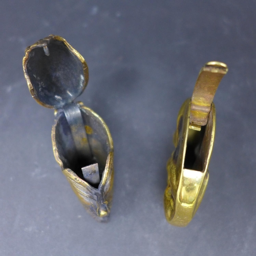 195 - Two brass vesta cases: one in the form of a smiling moon 4.2cm, one in the form of a grinning devil'...