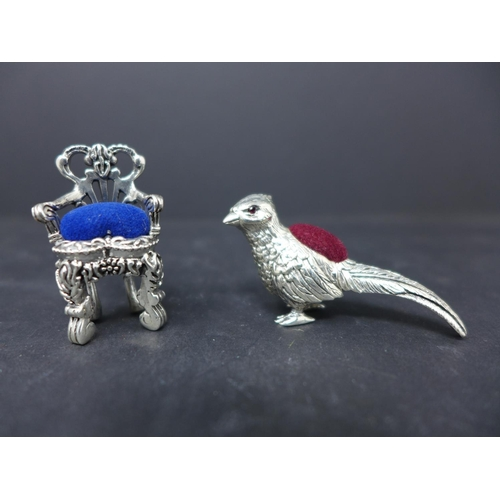196 - Two sterling silver pin cushions in the form of a miniature chair, 3.8 x 2.2cm, and a pheasant with ...