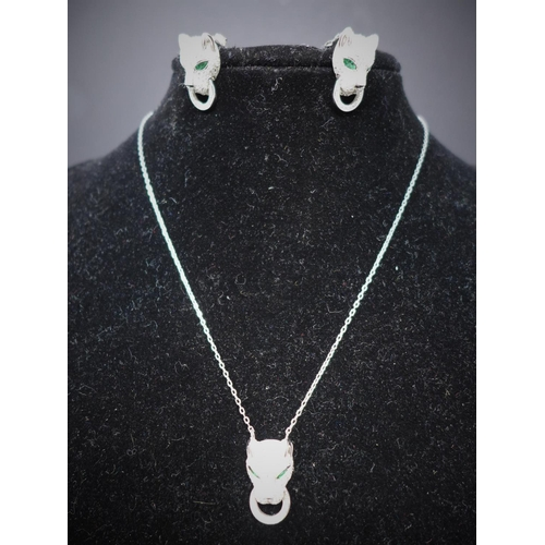 199 - A boxed sterling silver and white crystal suite, comprising of leopard head earrings and pendant on ...