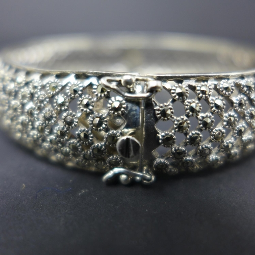 205 - A silver and marcasite hinged bangle, Diameter 6.5cm...