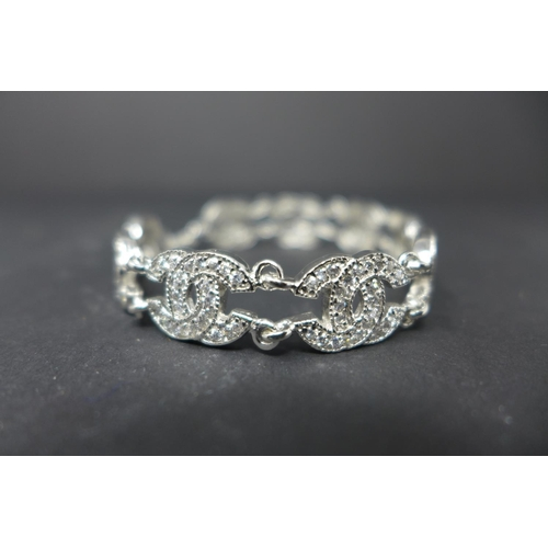 204 - WITHDRAWN-A silver and cubic zirconia Chanel style bracelet...