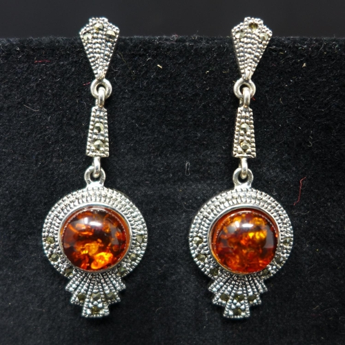 182 - Three pairs of silver earrings, to include one pair set with faux amber; one pair of fan design set ...