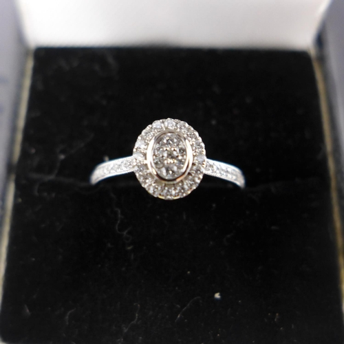 184 - An 18ct white gold and diamond cluster ring, 0.30cts total...