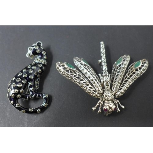211 - Two white metal brooches, to include one modelled as a leopard, H.5 W.2.5cm; the other modelled as a...