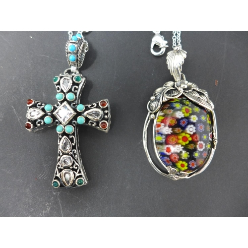 212 - Two silver pendant necklaces, to include one Murano Millefiori example in a pierced floral mount, H....