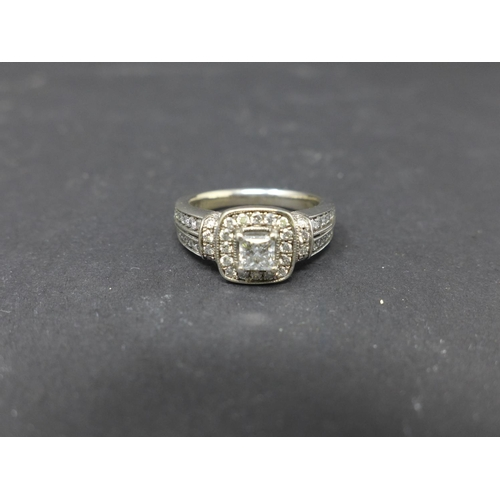 208 - An Art Deco style 14ct white gold and diamond cluster ring, size N 1/2...