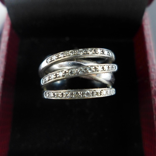 186 - An 18ct white gold and diamond cross-over ring, approx. size O...