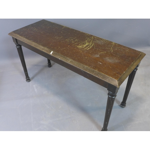 45 - A mid 20th century piano stool, with hinged lid, raised on turned legs, heavily scratched, H.51 W.90...