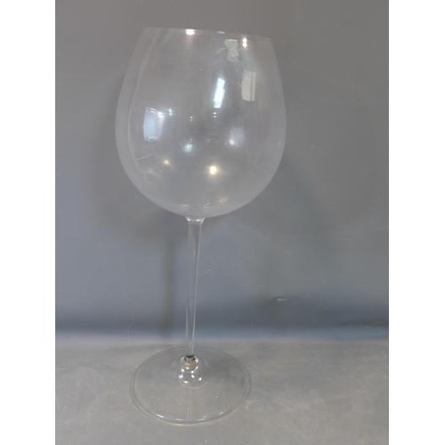 239 - A large novelty plastic wine glass, H.111cm...
