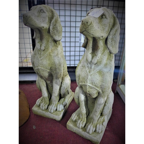 313 - A pair of reconstituted stone seated greyhounds, H.72 W.21 D.27cm...