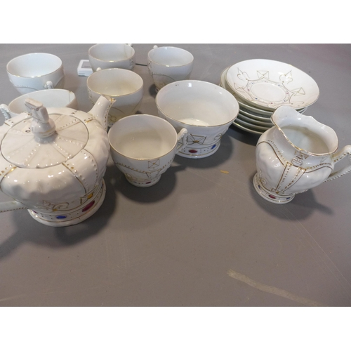 242 - Gothic revival Tea Set, consisting of six cups, saucers and sugar jar, 20th century...