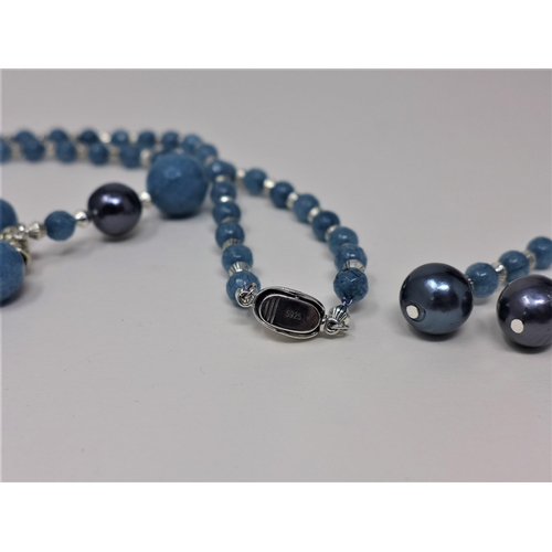 190 - An aquamarine beaded necklace together with a pair of aquamarine and faux pearl earrings...