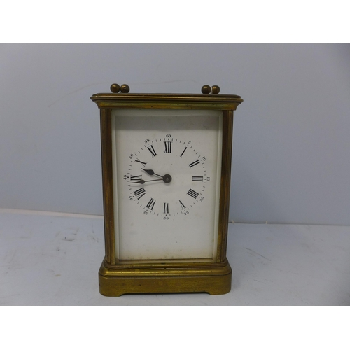 139 - An early 20th century French brass carriage clock by Richard & Cie, the white dial with Roman numera...