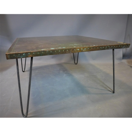 76 - A stud bound copper top low table, on hairpin legs, H.38 W.70 D.70cm...