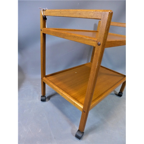 77 - A mid 20th century Danish teak two tier trolley, raised on castors, stamped 'Made in Denmark', H.70 ...