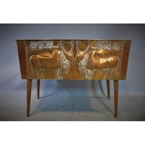 26 - A late 19th century copper planter, repoussé embossed with cattle, on splayed legs, H.55 W.70 D.28cm...