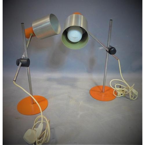 219 - Two vintage orange table lamps, on circular orange bases, H.42cm...