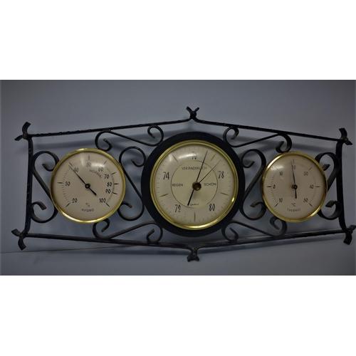 142 - A Veranderlich thermometer, hygrometer and barometer, in cast metal frame, H.16 W.35cm...