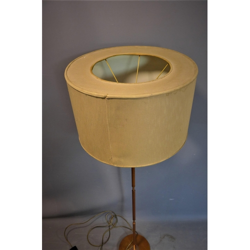 221 - A mid 20th century Temde teak standard lamp, with circular shade, H.157cm...