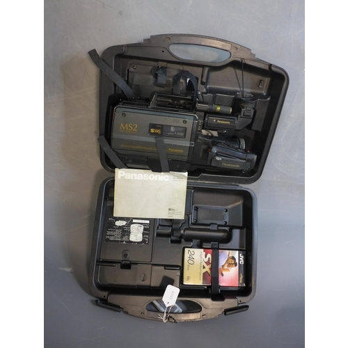246 - A vintage Panasonic S-VHS Movie Camera and Playback NV-MS2 HQ, cased and with a VHS tape, with instr...