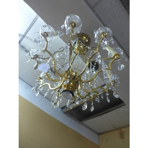 227 - Ten lights chandelier, brass, cut glass and crystal, mid 20th century...