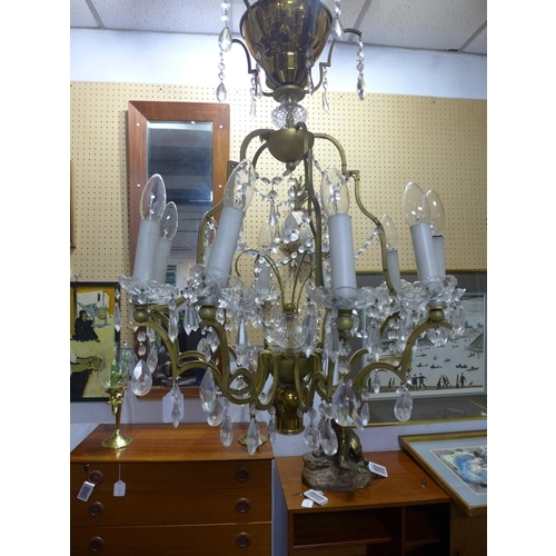 228 - Ten lights chandelier, brass, cut glass and crystal, mid 20th century...