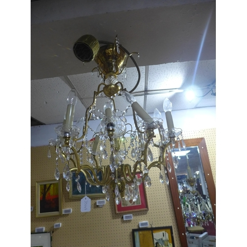229 - Ten lights chandelier, brass, cut glass and crystal, mid 20th century...
