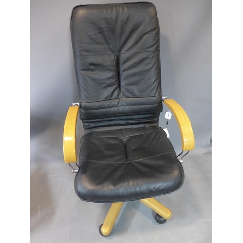 147 - A contemporary black leather swivel office chair, H.123cm...
