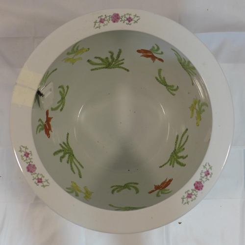 25 - A large 20th century Chinese porcelain jardiniere painted with flowers, ducks and fish, with charact...