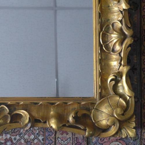226 - Ornately decorative gilt framed mirror...
