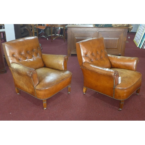 227 - Two leather armchairs...