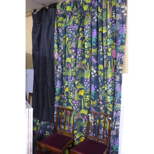 203 - A pair of lined curtains in black cotton and floral fabric designed by Josef Frank and made by speci...