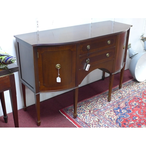 580 - A Regency style inlaid mahogany sideboard, with two drawers flanked by two cupboard doors, on tapere...