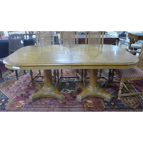 583 - A fruitwood extendable dining table, with two pedestals on turned supports, 75 x 285 x 115cm...