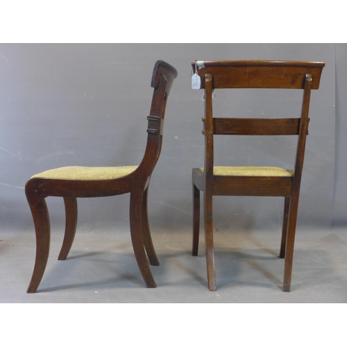 589 - A pair of Georgian mahogany dining chairs, with hessian drop in seats, on sabre legs...