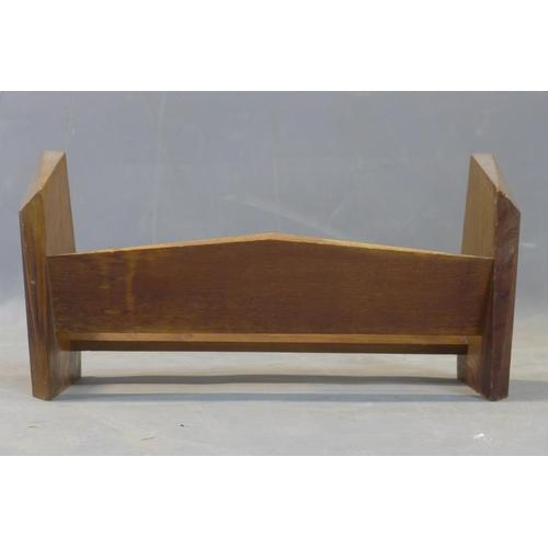 593 - A 1930's teak book trough, H.23 W.43 D.17cm...