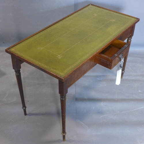 597 - A mahogany side table with green leather skiver, having single short drawer, raised on turned legs, ...