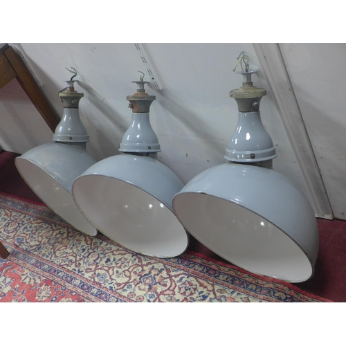 602 - Three Grey Crysteel parabolic industrial pendant lights from Benjamin Electric Manufacturing Company...