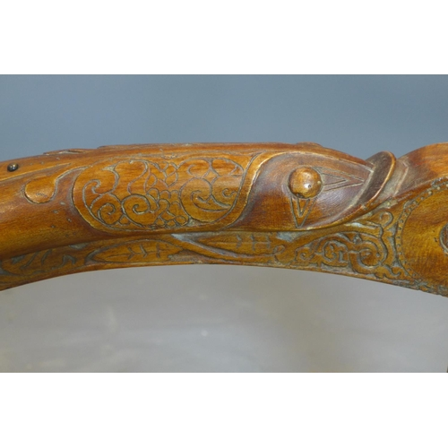 637 - A harp carved with beast heads and Celtic designs, reputedly from set of Lovejoy, having no strings,...