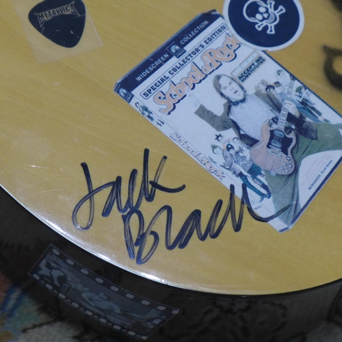 638 - A classical guitar with stickers and stencils for 'The School of Rock' movie, signed and inscribed b...