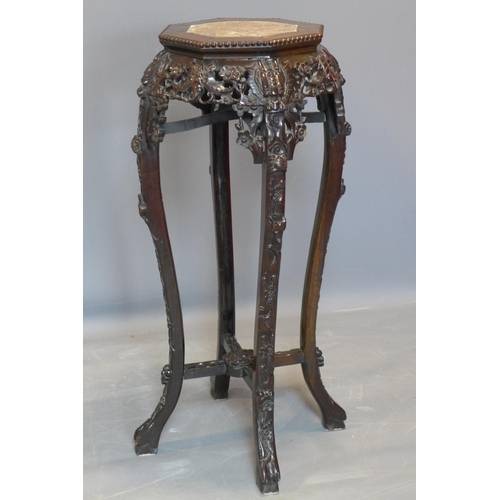 641 - A 19th century mahogany jardiniere stand, with octagonal top with marble to centre within beaded edg...