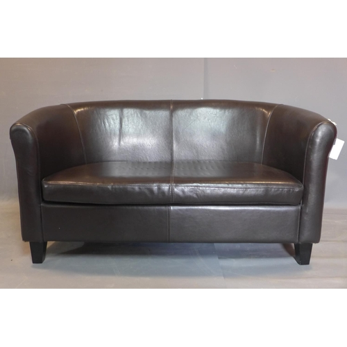 653 - A two seater faux leather sofa, on tapered block feet, H.75 W.142 D.70cm...