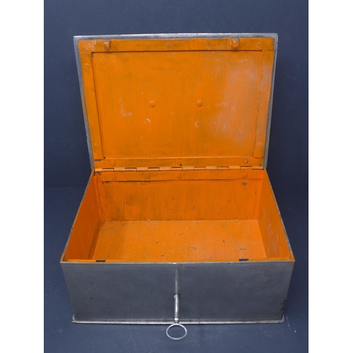 668 - An early 20th century cast metal strong box, with hinged lid and key, painted orange interior, H.10 ...