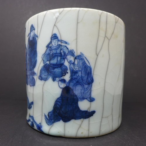 672 - A Chinese crackle glazed brush pot, decorated in blue with seated figures, H.15.5cm Diameter 16.5cm...